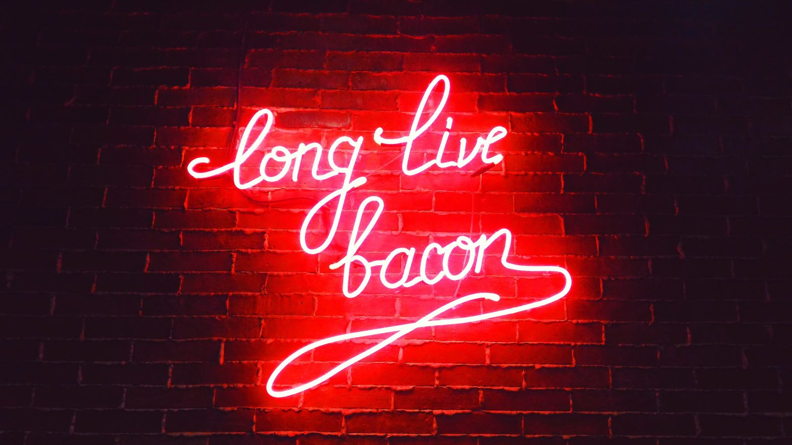 "neon sign that says ""long live bacon"""
