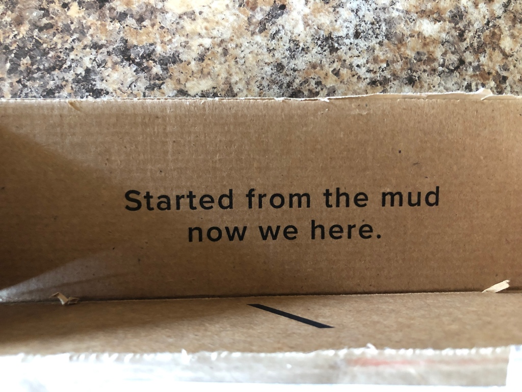 "MUD/WTR packaging that reads ""Started from the mud now we here."""
