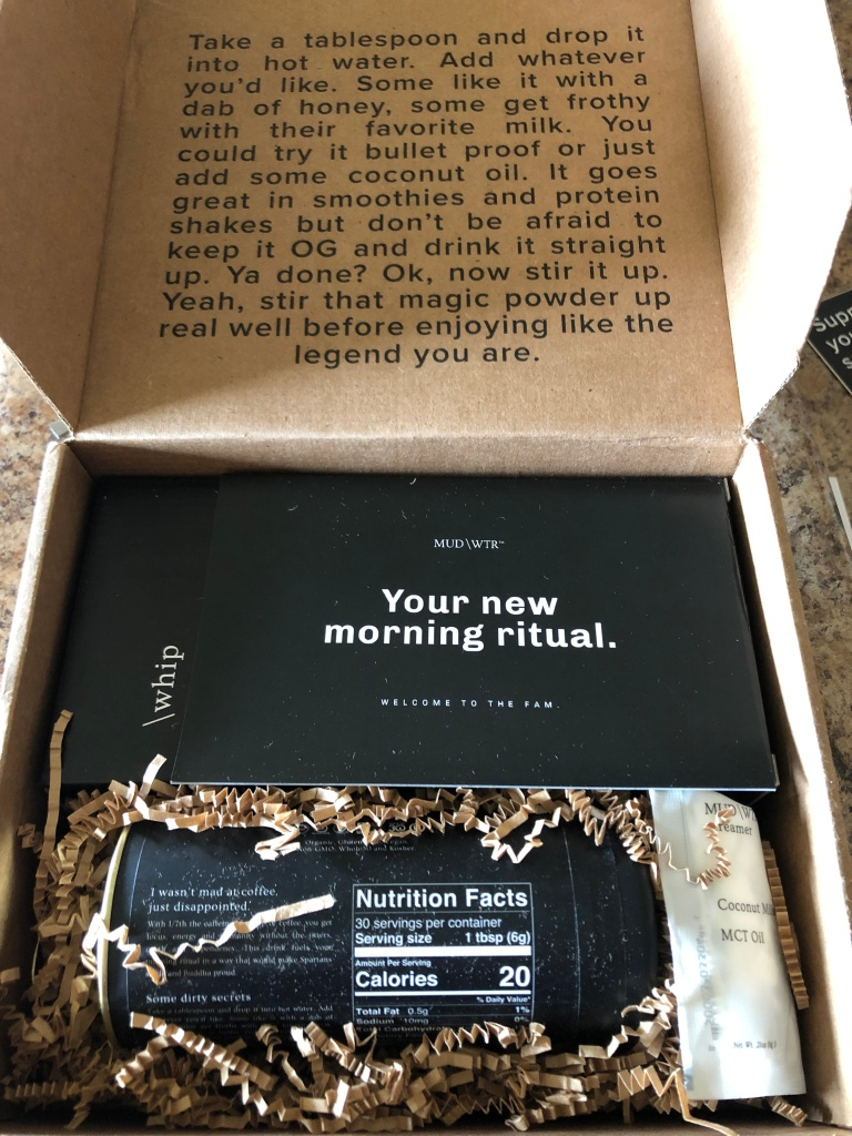 MUD/WTR unboxing with product shown inside.