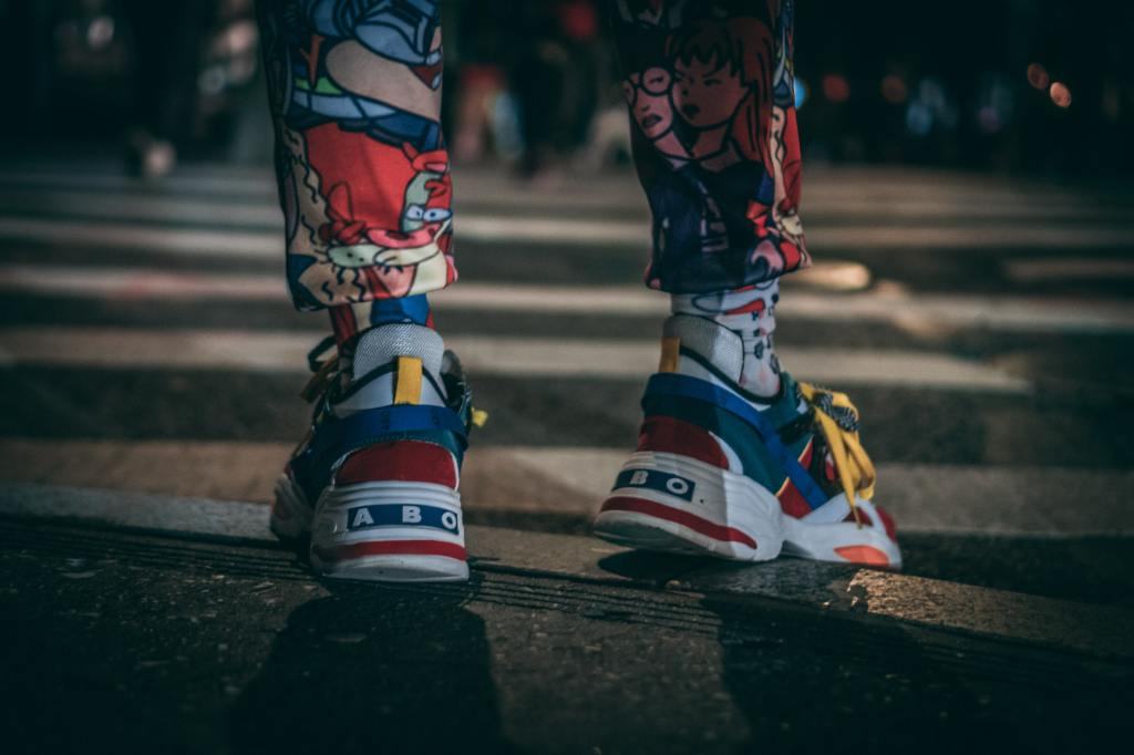 Person walking while wearing brightly colored tights and shoes from Magnus Olsson, Unsplash